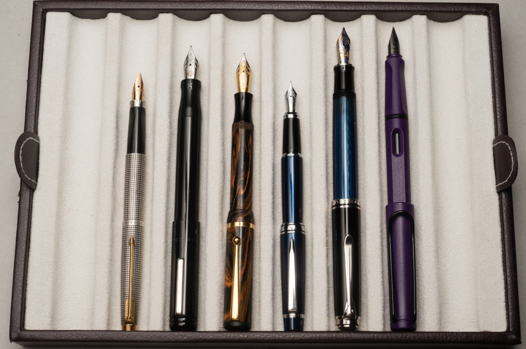 Posted pens from left to right: Parker 75, Franklin-Christoph Model 20, Edison Beaumont, Pilot Stargazer, Pelikan M805, and Lamy Safari