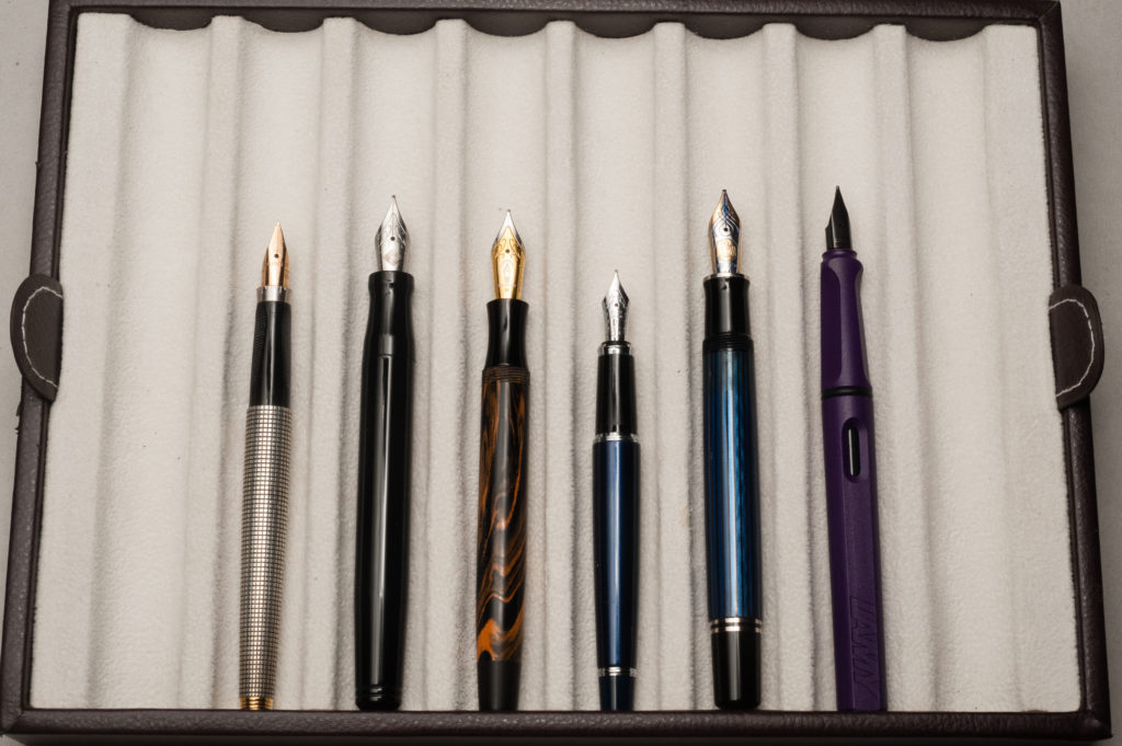Unposted pens from left to right: Parker 75, Franklin-Christoph Model 20, Edison Beaumont, Pilot Stargazer, Pelikan M805, and Lamy Safari