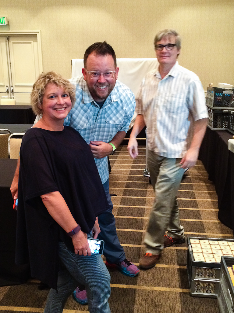 Lisa Vanness, Brad Dowdy, and Mike Vanness taking a sec for a quick photo as they set up their table. They're always so fun to see at the show,