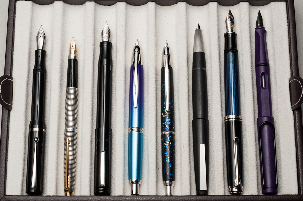 Posted pens from left to right: Edison Beaumont, Parker 75, Franklin-Christoph Model 20, Pilot Vanishing Point, Pilot Vanishing Point Decimo, Lamy 2000, Pelikan M805, and Lamy Safari