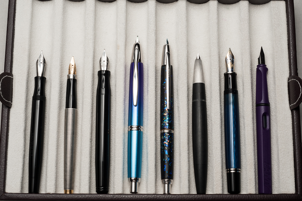 Unposted pens from left to right: Edison Beaumont, Parker 75, Franklin-Christoph Model 20, Pilot Vanishing Point, Pilot Vanishing Point Decimo, Lamy 2000, Pelikan M805, and Lamy Safari
