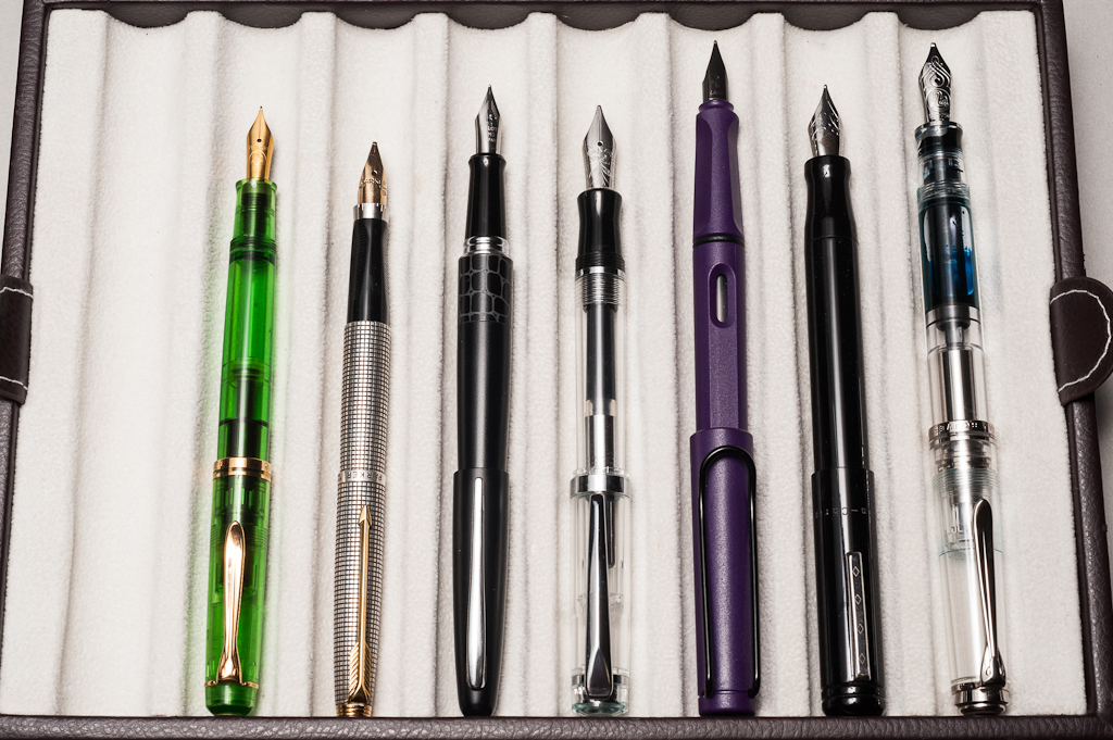 Posted pens from left to right: Pelikan M200, Parker 75, Pilot Metropolitan, *Nemosine Singularity*, Lamy Safari, Franklin-Christoph Model 20, and Pelikan M805