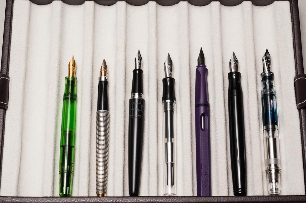 Unposted pens from left to right: Pelikan M200, Parker 75, Pilot Metropolitan, *Nemosine Singularity*, Lamy Safari, Franklin-Christoph Model 20, and Pelikan M805
