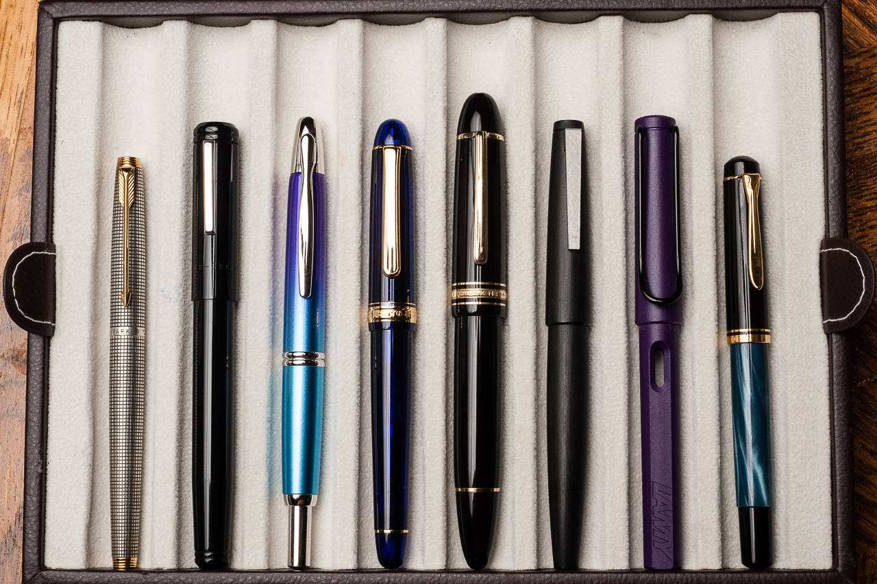 Closed pens from left to right: Parker 75, Franklin-Christoph Model 20,  Pilot Vanishing Point, Platinum 3776, *Montblanc 149*, Lamy 2000, Lamy  Safari, ...